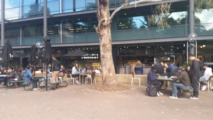 Students in the café outside the library, UOW